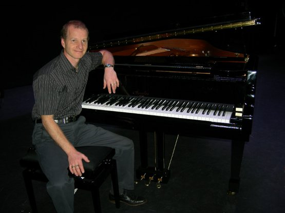 Martin with the Irmler grand piano at The Regent Centre